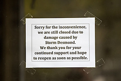 © Licensed to London News Pictures. 11/05/2016. Glenridding UK. Picture taken 10/05/2016 shows a sign on the window of the Glenridding village food store five months after storm Desmond flooded the village. The diggers are still in the village of Glenridding five months after storm Desmond hit the area & flooded the village three times last December. Residents of the village have become frustrated at the Environment Agency after it took almost four months for the agency to start work on new flood defences leaving the village looking like a building site during the normally busy tourist period essential to get the area back on it's feet. Photo credit: Andrew McCaren/LNP