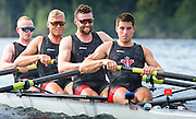 Members of the Canadian Olympic mens rowing four (left to right) Will Crothers, Tim Schrijver, Conlin McCabe and Kai Langerfeld row during a morning training session on Elk Lake in Victoria, British Columbia on June 22, 2016.