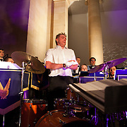 Drummer Jason 'Radox' keeps the beat. Jeremy Deller's Acid Brass featuring Fairey Brass Band in the Duveen Galleries. The brass band plays a set of old classic acid tracks live to a wild audience. Late at Tate Britain. A free evening of performance and installations from Warp Records and Jeremy Deller, inspired by Deller's work 'The History of the World'.