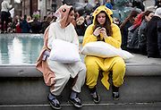 Photographer: Rick Findler<br /> <br /> 04.04.15 A massive pillow fight breaks out in Trafalgar Square, London this afternoon for International Pillow Fight Day. Thousands of people gathered in the capitals square for the annual event, which takes place in cities across the world. <br /> Pictured - pillow fighters in costume take a rest.