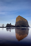 A series of irregular basalt rock projections along Cannon Beach on the Oregon Coast. The largest is known as Haystack Rock - seen at sunrise.