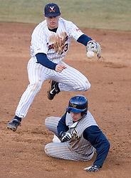 Virginia Cavaliers infielder David Adams (23) turns a double play against GWU.  The Virginia Cavaliers Baseball Team defeated the George Washington University Colonials 11-0 in the first of a three game series on February 17, 2007 at Davenport Field, Charlottesville, VA.