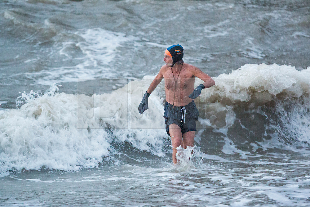 © Licensed to London News Pictures. 19/11/2015. Brighton, UK. Members of the Brighton and Hove sea swimming club take part in their early morning exercise while Storm Barney hots Brighton with powerful waves. Today November 19th 2015. Photo credit : Hugo Michiels/LNP