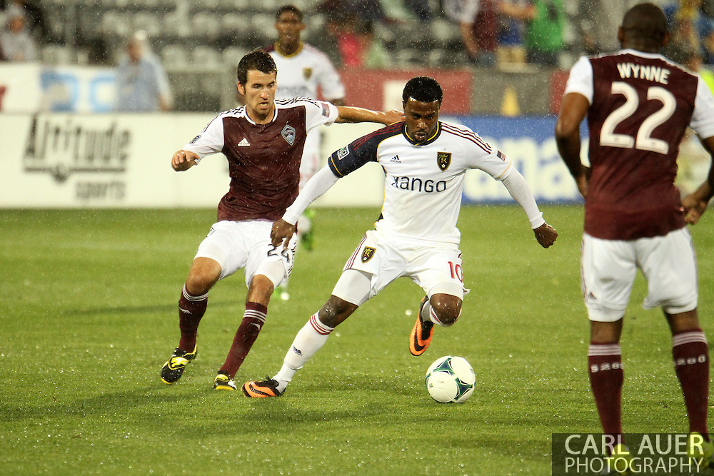 August 3rd, 2013 - Real Salt Lake forward Robbie Findley (10) controls the ball between Colorado Rapids defender Marvell Wynne (22) and midfielder Nathan Sturgis (24) in first half action of the Major League Soccer match between Real Salt Lake and the Colorado Rapids at Dick's Sporting Goods Park in Commerce City, CO