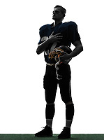 one  american football player man hand on heart in silhouette studio isolated on white background