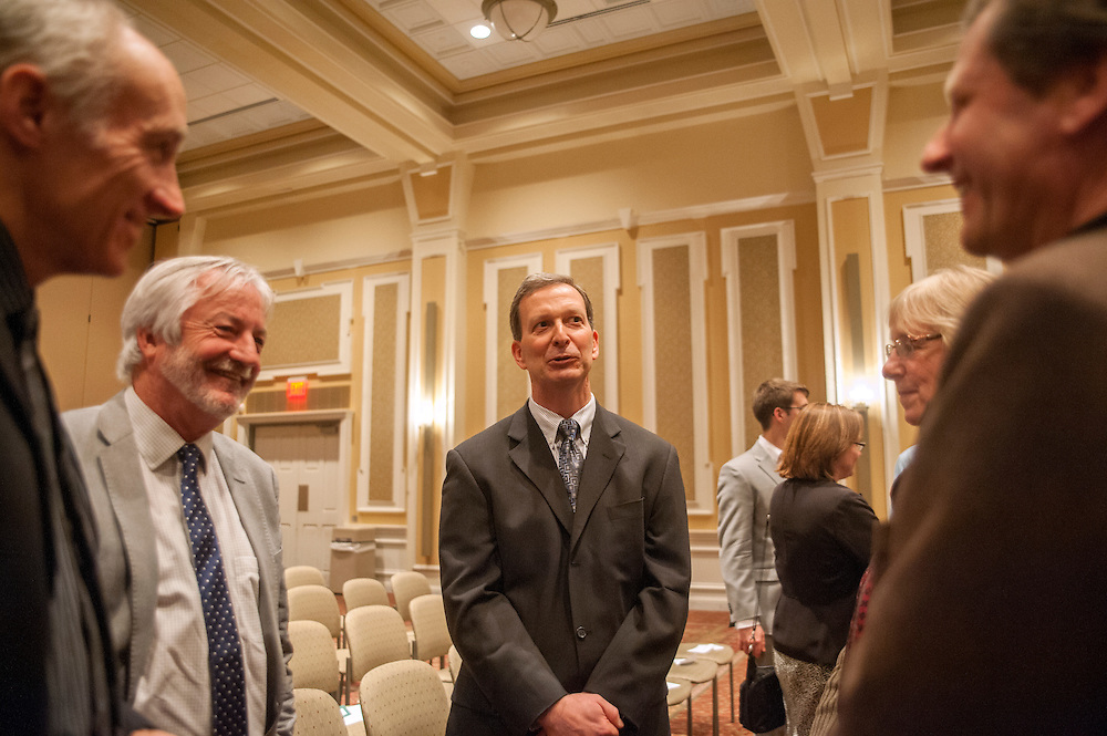 Dr. Christopher France speaks with Mark Halliday, Damian Nance, Dr. Peter Jung and Karen Peterson-Jung in Baker University Center Ballroom on Tuesday, March 10 after receiving the 2014 Distinguished Professor Award.