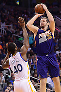 Feb 10, 2016; Phoenix, AZ, USA; Phoenix Suns forward Mirza Teletovic (35) shoots the ball over Golden State Warriors forward Harrison Barnes (40) at Talking Stick Resort Arena. The Golden State Warriors won 112-104. Mandatory Credit: Jennifer Stewart-USA TODAY Sports