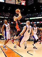 Jan. 24, 2012; Phoenix, AZ, USA; Toronto Raptors guard Linas Kleiza (11) drives the ball against the Phoenix Suns guard Sebastian Telfair (31) , center Marcin Gortat (4) and forward Hakim Warrick (21) during the first half at the US Airways Center. The Raptors defeated the Suns 99-96.  Mandatory Credit: Jennifer Stewart-US PRESSWIRE.