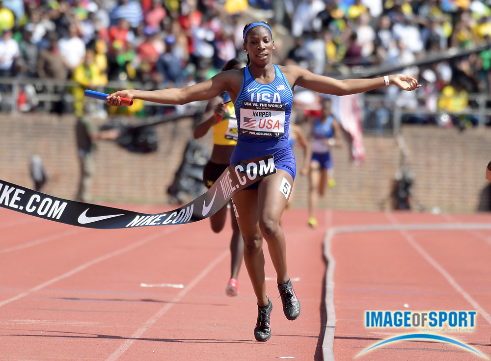 Apr 28, 2018; Philadelphia, PA, USA; Daina Harper celebrates after running the anchor leg on the USA Red women's 4 x 400m relay that won the USA vs. The World race in 3:26.73 during the 124th Penn Relays at Franklin Field.