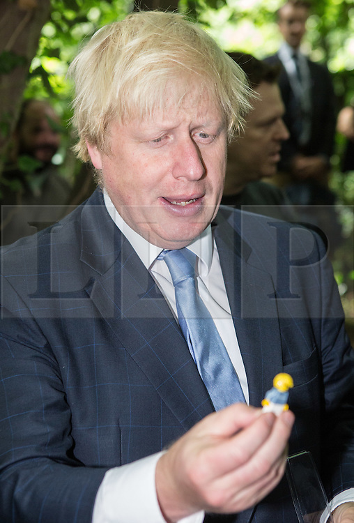 © Licensed to London News Pictures. 30/07/2015. London, UK. The Mayor of London and MP for Uxbridge and South Ruislip Boris Johnson is presented with a Lego version of himself during a visit to the Wide Horizons Environment Centre in Bexley where he explored their new outdoor learning centre which was built by an 'army of volunteers' on a once derelict site. Photo credit : James Gourley/LNP