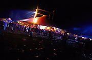 Crowds of clubbers in a large tent at night dance music event Slovakia Bratislava July 2002