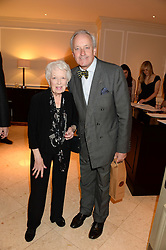 JUNE WHITFIELD and NEIL HAMILTON at the 90th birthday party for Nicholas Parsons held at the Hyatt Churchill Hotel, Portman Square, London on 8th October 2013.