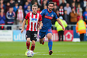 Lincoln City midfielder Joe Morrell (19) under pressure from Sunderland forward Will Grigg (22) during the EFL Sky Bet League 1 match between Lincoln City and Sunderland at Sincil Bank, Lincoln, United Kingdom on 5 October 2019.
