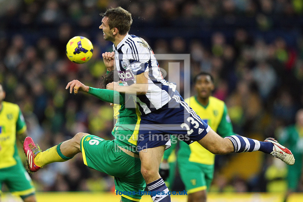 Picture by Paul Chesterton/Focus Images Ltd +44 7904 640267<br /> 07/12/2013<br /> Johan Elmander of Norwich and Gareth McAuley of West Brom in action during the Barclays Premier League match at The Hawthorns, West Bromwich.