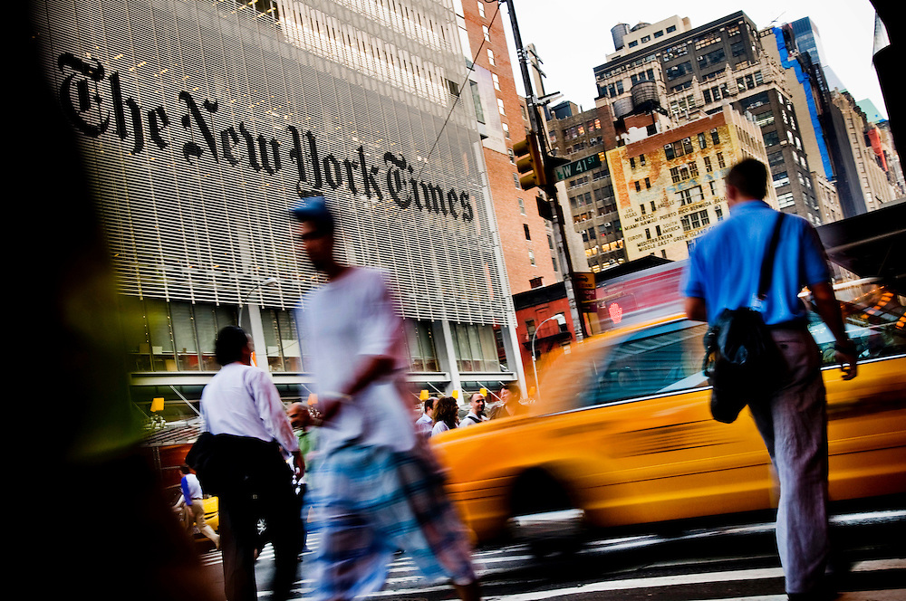 Crisis in the newspaper industry.  New Yorkers and their news reading habits...People outisde the New York Times building on 8th avenue and 41st street...Photographer Chris Maluszynski /MOMENT