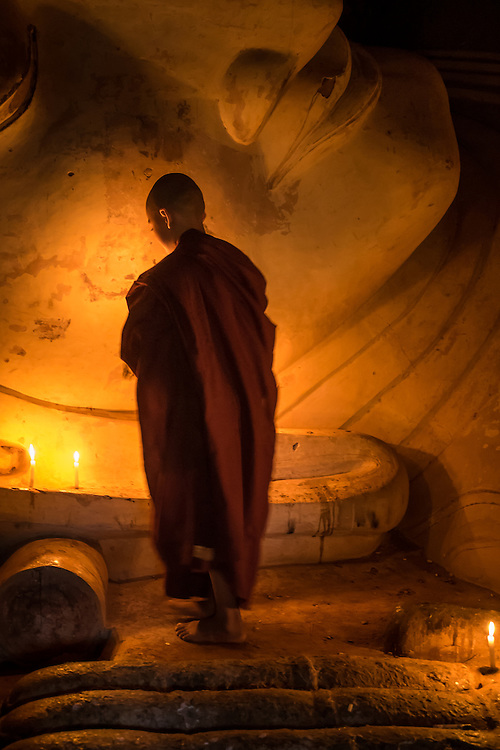 BAGAN, MYANMAR - CIRCA DECEMBER 2013: Younk Monk paying tribute to Buda in the Shwesandaw Pagoda in Bagan