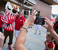 A man poses for a picture with Bucky Badger at Badger Bash at Union South in 2014.