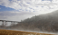 Salisbury Mills, New York -  Sunlight burns off the fog at the Moodna Viaduct railroad trestle by Schunnemunk Mountain on a warm winter day on Jan. 2, 2010.