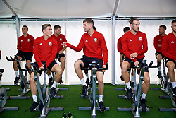 CARDIFF, WALES - Monday, September 3, 2018: Wales' Harry Wilson, Chris Mepham and Gareth Bale on warm-up bikes in the pre-activation tent before a training session at the Vale Resort ahead of the UEFA Nations League Group Stage League B Group 4 match between Wales and Republic of Ireland. (Pic by David Rawcliffe/Propaganda)