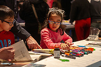 Friends and family came Monday afternoon, January 21st, 2019 to experience the grand opening of Black Creativity 2019 and participate in family style art projects at the Museum of Science and Industry located at 5700 S. Lake Shore Drive.<br /> <br /> 6016 &ndash; Sarah Baggin and her brother Ayaaz work on a large photo collage.<br /> <br /> Please 'Like' &quot;Spencer Bibbs Photography&quot; on Facebook.<br /> <br /> Please leave a review for Spencer Bibbs Photography on Yelp.<br /> <br /> Please check me out on Twitter under Spencer Bibbs Photography.<br /> <br /> All rights to this photo are owned by Spencer Bibbs of Spencer Bibbs Photography and may only be used in any way shape or form, whole or in part with written permission by the owner of the photo, Spencer Bibbs.<br /> <br /> For all of your photography needs, please contact Spencer Bibbs at 773-895-4744. I can also be reached in the following ways:<br /> <br /> Website &ndash; www.spbdigitalconcepts.photoshelter.com<br /> <br /> Text - Text &ldquo;Spencer Bibbs&rdquo; to 72727<br /> <br /> Email &ndash; spencerbibbsphotography@yahoo.com<br /> <br /> #SpencerBibbsPhotography <br /> #HydePark <br /> #Community <br /> #Neighborhood<br /> #CanonUSA