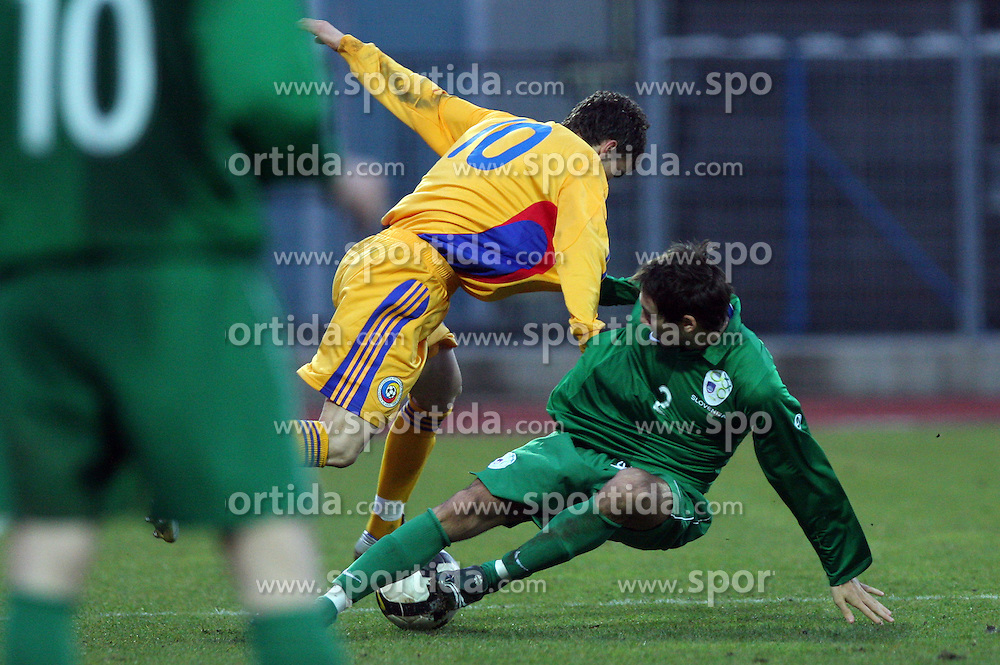 Costantin Gangioveanu of Romania vs Ales Majer (2)  of Slovenia during Friendly match between U-21 National teams of Slovenia and Romania, on February 11, 2009, in Nova Gorica, Slovenia. (Photo by Vid Ponikvar / Sportida)