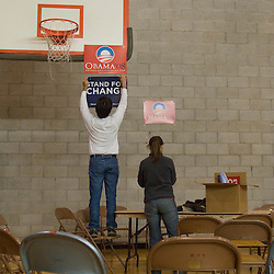 Alex, left, and Jelena Hartman hang signs for democratic presidential candidate, Sen. Barack Obama at Reno High School, a presidential caucus site in Reno, Saturday, Jan. 19, 2008...Photo by David Calvert/Bloomberg News
