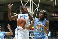 03 March 2013: Duke's Elizabeth Williams (1) and North Carolina's Tierra Ruffin-Pratt (44). The Duke University Blue Devils played the University of North Carolina Tar Heels at Cameron Indoor Stadium in Durham, North Carolina in a 2012-2013 NCAA Division I and Atlantic Coast Conference women's college basketball game. Duke won the game 65-58.