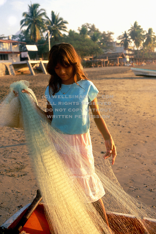 Image of a young girl with fishing net in Zihuatenejo, Mexico