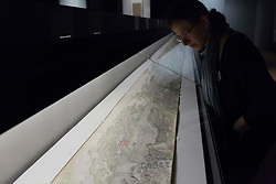 © Licensed to London News Pictures. 23/10/2013. London, UK. A member of Victoria and Albert Museum staff views 'Prosperous Suzhou' (1759) a panorama by Xu Yang at the press view for 'Masterpieces of Chinese Painting 700 - 1900' at the museum in London today (23/10/2013). The exhibition, running from the 26th of October 2013 to the 19th of January 2014, features some of the finest examples of Chinese painting created over a 1200 year period. Photo credit: Matt Cetti-Roberts/LNP