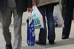 © Licensed to London News Pictures. 04/06/2014<br /> Shoppers in Bromley High Street,Bromley,Kent using plastic bags today (4.06.2014)<br /> The Queen will tell Parliament today that a 5p charge for plastic bags will be introduced next year.  This will affect supermarkets and larger stores on the UK''s high streets.<br /> Photo credit :Grant Falvey/LNP