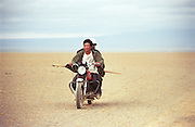 photos from travels in Mongolia - riding a motorcycle in the Gobi Desert -<br /> <br /> Photo must be credited to &quot;Jacques-Jean Tiziou / www.jjtiziou.net&quot; adjacent to the image. Online credits should link to www.jjtiziou.net. Photo may only be used as permitted by the photographer.
