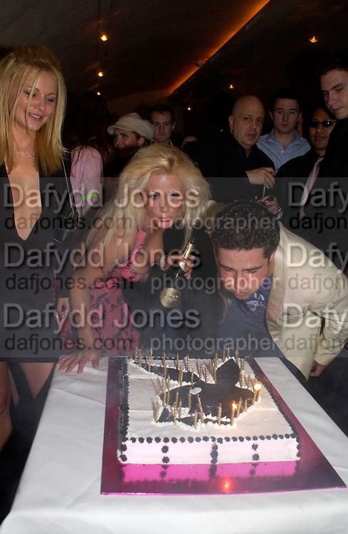 Luci  Victoria, the first UK girl to have posed for the American edition of Playboy  in over 20 years and Luca de Bono, . Playboy and Beat celebrate Playboy's 50th anniversary Designer collection. Adam St. club. 19 March 2004. ONE TIME USE ONLY - DO NOT ARCHIVE  © Copyright Photograph by Dafydd Jones 66 Stockwell Park Rd. London SW9 0DA Tel 020 7733 0108 www.dafjones.com