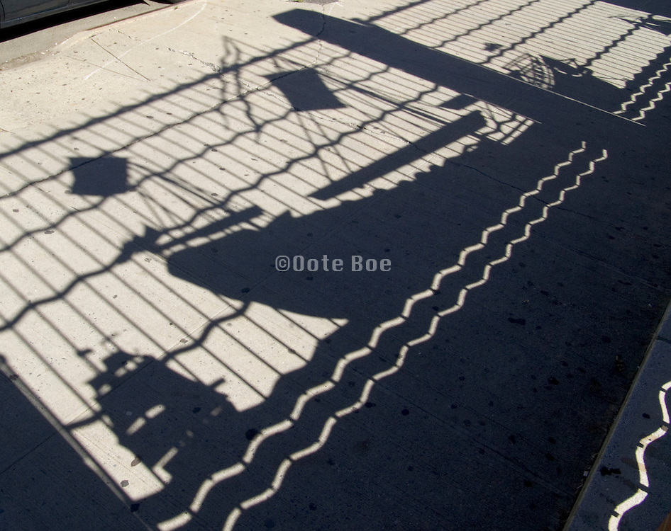 shadow of old wooden ships on pavement