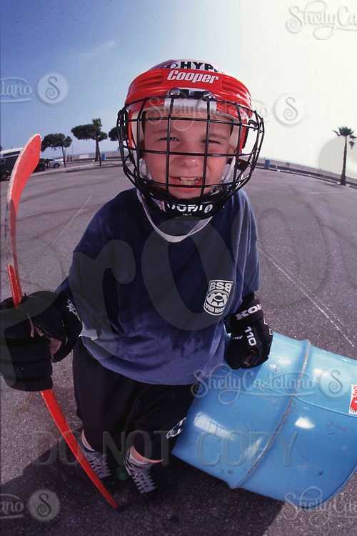 May 22, 2002; Santa Monica, CA, USA; Roller Hockey and Inline Skating is a hot sport in 2002. Kids, women, adults are playing in leagues throughout the United States and Canada that play year around. Kid stands by beach hockey goal after playing a co-ed street hockey type game. <br />