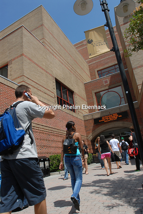 Students walk to to the Student Union building between classes at the University of Central Florida in Orlando, Florida.