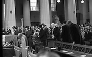 State Funeral Of Mrs Thomas Clarke..1972..08.10.1972..10.08.1972..8th October 1972..Today the state funeral of Mrs Kathleen Clarke took place at the Pro Cathedral,Dublin. Mrs Clarke was the wife of the late Thomas Clarke who was executed in Kilmainham Jail in 1916. Thomas Clarke was a signatory of the Irish Proclamation of 1916...Picture taken as family members and representatives of the political parties attend the altar for communion. An Taoiseach,Mr jack Lynch is seen kneeling at the rail.