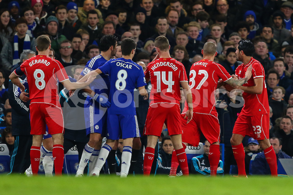 Martin Skrtel of Liverpool (2nd right) pushes Emre Can of Liverpool away from Diego Costa of Chelsea (2nd left) as tempers flair during the Capital One Cup Semi Final 2nd Leg match between Chelsea and Liverpool at Stamford Bridge, London, England on 27 January 2015. Photo by David Horn.