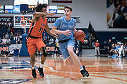 San Diego Toreros guard Finn Sullivan (5) drives against Cal State Fullerton Titans guard Wayne Arnold (11) during an NCAA basketball game, Wednesday, Dec. 11, 2019, in Fullerton, Calif. San Diego defeated CSUF 66-54. (Jon Endow/Image of Sport)