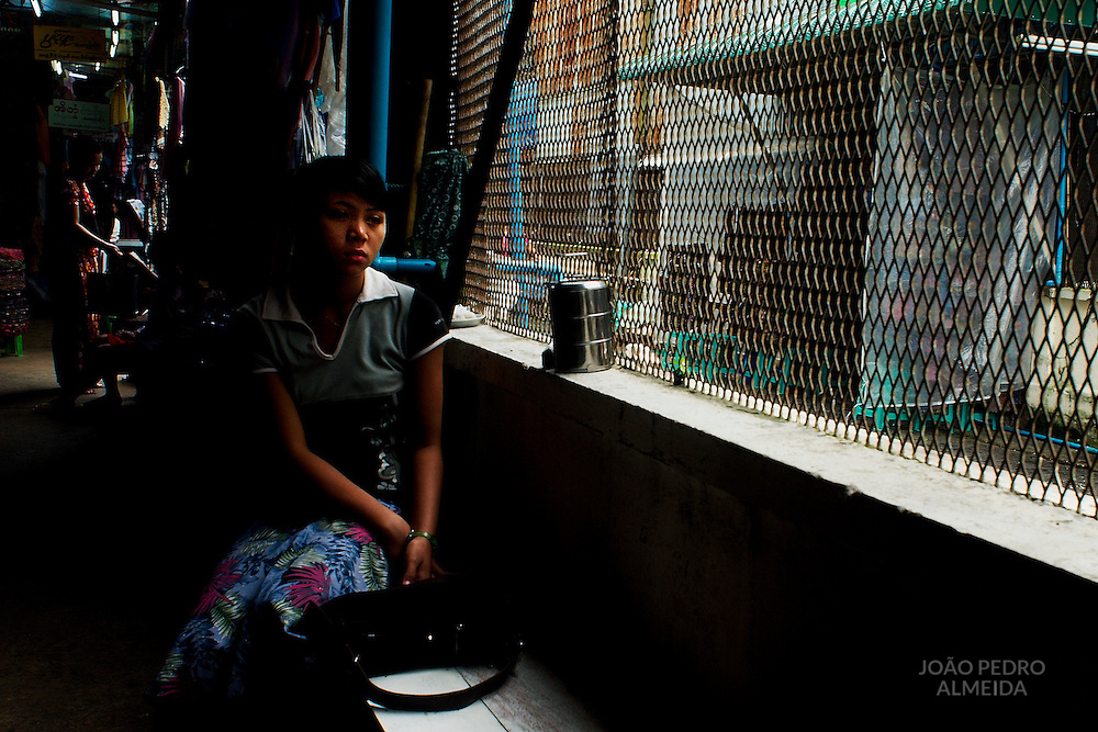 Girl resting at the Bogyoke Aung San Market