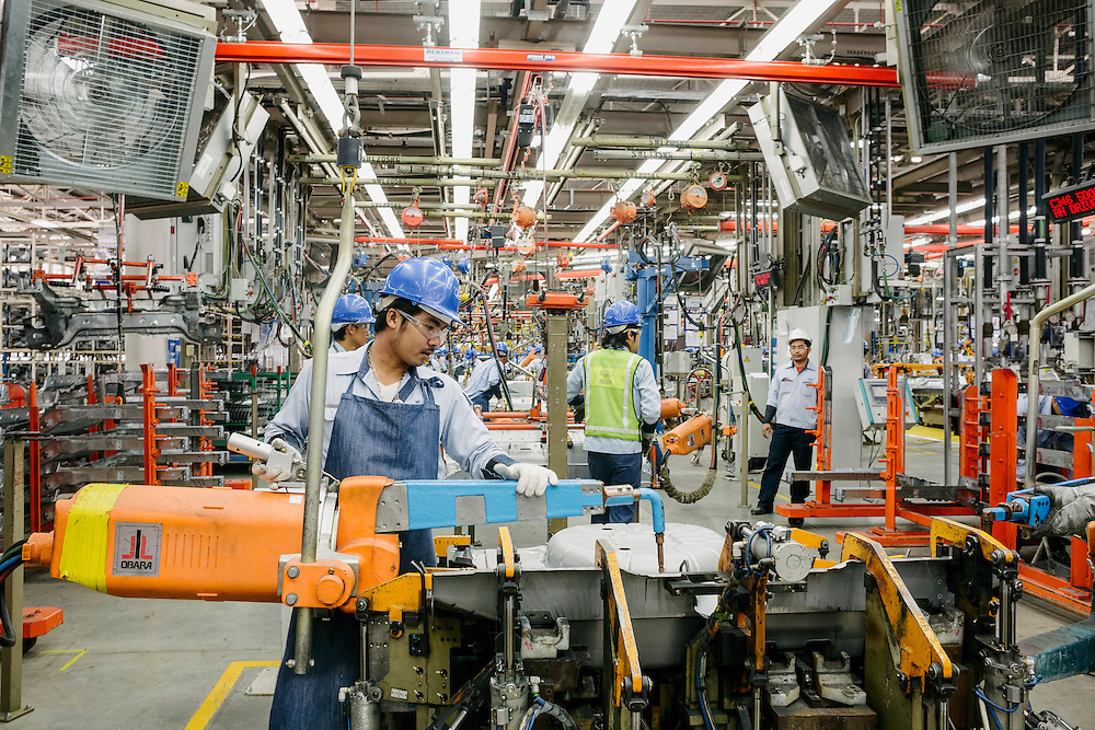 Workers at the new and most state of the art Ford Factory in the world. Built in Rayong this area has become known as the Detroit of the East. Detroit-based General Motors Co. and Ford Motor Co., have modern factories here. Japanese carmakers have also set up even bigger production bases. Last year Thailand leapfrogged Canada, France, Spain, Russia and the U.K to become the world's 9th biggest motor vehicle manufacturer, producing 2.5 million cars and trucks. That's almost a 10-fold increase in 12 years. Only a small percentage of those vehicles are sold in Thailand. Today, for example, almost one-fifth of all cars imported into Australia are manufactured in the Detroit of the East. From its Rayong base, Ford exports light trucks to markets as far afield as Pakistan and Ireland. And in 2015, when a 10 - nation Southeast Asian common market takes effect, Thai-made cars will become more competitive in a region of 600 million increasingly wealthy consumers. Rayong, Thailand.