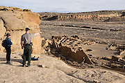 The fun Pueblo Alto Trail overlooks Pueblo Bonito, a monumental public building (Puebloan Great House) occupied from around 828 to 1126 AD, now preserved at Chaco Culture National Historical Park, New Mexico, USA. The huge D-shaped complex of Pueblo Bonito enclosed two plazas with dozens of ceremonial kivas, plus 600 rooms towering 4 and 5 stories above the valley floor. The functions of this building included ceremony, administration, trading, storage, hospitality, communications, astronomy, and burial, but few living quarters. Chaco Culture NHP hosts the densest and most exceptional concentration of pueblos in the American Southwest and is a UNESCO World Heritage Site, located in remote northwestern New Mexico, between Albuquerque and Farmington. From 850 AD to 1250 AD, Chaco Canyon advanced then declined as a major center of culture for the Ancient Pueblo Peoples. Chacoans quarried sandstone blocks and hauled timber from great distances, assembling fifteen major complexes that remained the largest buildings in North America until the 1800s. Climate change may have led to its abandonment, beginning with a 50-year drought starting in 1130.