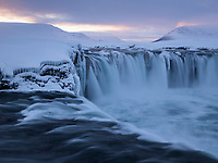 Goðafoss waterfall at sunset in winter. North Iceland.