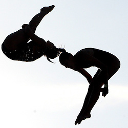Divers silhouetted during the Kaiser Permantente 2008 National Diving Championships at the Rose Bowl Aquatics Center Wednesday, July 23, 2008, in Pasadena,Calif. <br /> (Pasadena Star-News Keith Birmingham)