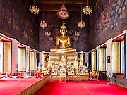 11 APRIL 2016 - BANGKOK, THAILAND:  The Buddha statue in the Viharn or Prayer Hall at Wat Ratchanatdaram (also known as Wat Ratchanatda). Wat Ratchanatdaram is a buddhist temple (wat) located at the intersection between Ratchadamnoen Klang and Maha Chai Road in Bangkok. The temple was built to the order of King Nangklao (Rama III) for the princess granddaughter, Somanass Waddhanawathy in 1846.   PHOTO BY JACK KURTZ