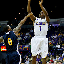 December 15, 2011; Baton Rouge, LA; LSU Tigers guard Anthony Hickey (1) shoots over UC Irvine Anteaters guard Derick Flowers (0) during the first half of a game at the Pete Maravich Assembly Center.  Mandatory Credit: Derick E. Hingle-US PRESSWIRE