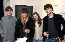 Left to right, CHARLES ARTSRUNIK, COUNTESS VALENTINA ARTSRUNIK wife of John McVicar, VASSILISSA ARTSRUNIK and NICHOLAS ARTSRUNIK at an exhibition of artist Jonathan Yeo's portrait paintings held at Eleven, 11 Eccleston Street, London SW1 on 16th February 2006.<br />