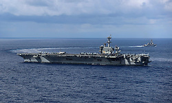 ATLANTIC OCEAN (Aug. 28, 2018) The Arleigh Burke-class guided-missile destroyer USS Mason (DDG 87), top, pulls away from the Nimitz-class aircraft carrier USS Abraham Lincoln (CVN 72) following an underway replenishment. Abraham Lincoln is underway with Carrier Strike Group 12 (CSG 12) conducting Operational Test-1 (OT1) for the F-35C Lightning II. (U.S. Navy photo by Mass Communication Specialist 3rd Class Jeff Sherman/Released) 180828-N-FQ836-1207