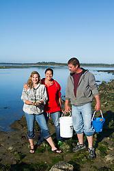 Digging for clams in Tillamook Bay. Garabaldi, OR