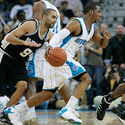 29 March 2009: New Orleans Hornets guard Chris Paul (3) drives past San Antonio Spurs guard Tony Parker (9) during a 90-86 victory by the New Orleans Hornets over Southwestern Division rivals the San Antonio Spurs at the New Orleans Arena in New Orleans, Louisiana.