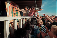 DADE CITY, FLORIDA:  Pilgrims crowd around the porch as the family of Vimer Nagun  hand out cotton balls wiped on the painting of the Virgin Mary they claim cries tears of oil. Thousands of pilgrims visited the home during the first few days of Nagun's apparitions. (Photo by Robert Falcetti). .